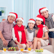 Family by Christmas table — Stock Photo