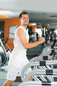 Man on treadmill — Stock Photo