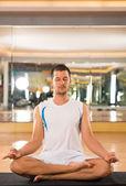 Meditating in gym — Stok fotoğraf