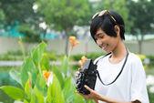 Woman with a retro camera — Stock Photo