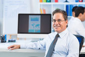 Mature businessman — Stock Photo