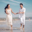 Couple running on a beach — Stock Photo #39886559