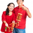 Grandparents holding Tet decorations — Stock Photo