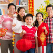 Family showing Tet symbols — Stock Photo