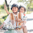 Happy seniors on scooter — Stock Photo #39886931