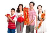 Happy family with Tet symbols — Stock Photo