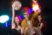 Friends clubbing — Stock Photo