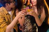 Young friends in the night club — Stock Photo