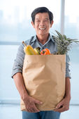 Senior man with a paperbag — Stock Photo