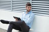 Businessman holding a digital tablet — Stock Photo