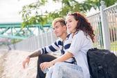 Couple resting after a tiresome walk — Stock Photo
