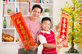 Father and his son holding red textiles — Stock Photo