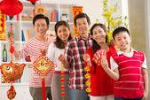 Big family holding Tet symbols — Stock Photo