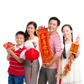Family with Tet ornaments — Stock Photo