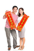 Married couple holding red textiles — Stock Photo