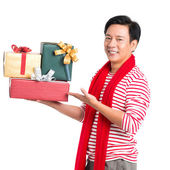 Man holding xmas presents — Stock Photo