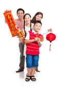 Family with red Tet symbolic — Stock Photo