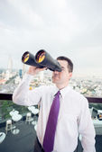 Businessman with the binoculars — Stock Photo