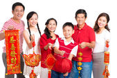 Big family with Tet decorations — Stock Photo