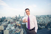 Businessman standing on the roof — Stock Photo