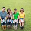 Students on lawn — Stock Photo