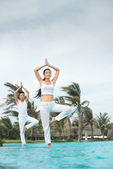 Yoga near water — Stock Photo