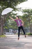 Flying with an umbrella — Stockfoto
