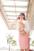 Businesswoman talking by phone in the store — Stock Photo