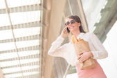 Lady talking by phone — Stock Photo