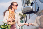 Woman trying to open her car — Stock Photo