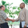 Stock Photo: Partners handshaking