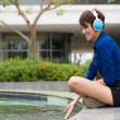 Stock Photo: Womin headphones