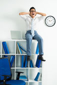Businessman on cupboard — Stock Photo