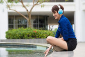 Woman in headphones — Stock Photo