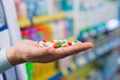 Hand with colorful pills — Stock Photo