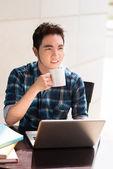 Guy drinking coffee — Stock Photo
