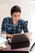 Guy computing at cafe — Stock Photo
