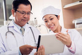 Asian medical workers — Stock Photo
