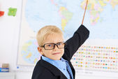 Little teacher of geography — Stock Photo