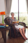 Reading in chair — Stock Photo