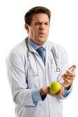 Doctor injecting apple — Stock Photo