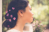 Flowers in hair — Stock Photo