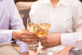 Clinking glasses with wine — Stock Photo