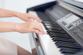 Female hands over piano — Stock Photo