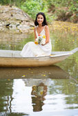 Beautiful woman in boat — Stock Photo