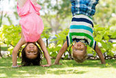 Children standing on their hands — Stock Photo