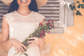 Unrecognizable woman with bouquet — Stock Photo