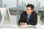 Smiling businessman at work — Stock Photo