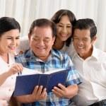 Senior people watching a photo album — Stock Photo #50349217