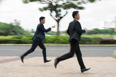Two managers running outdoors — Stock Photo